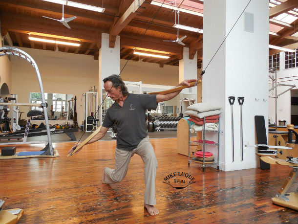 Lunging and rotating exercise with the Gyrotonic Wingmaster
