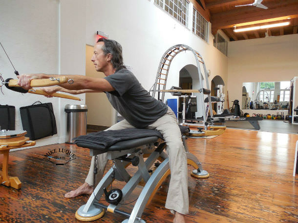 Seated strengthening exercise with the Gyrotonic Wingmaster