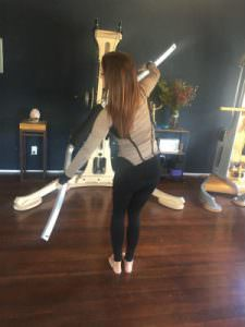 Trainer Kerri Affronti using the Gyrotonic Wingmaster in a standing series