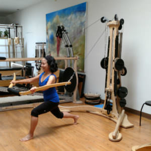 Gyrotonic trainer June Chiang working with the Wingmaster